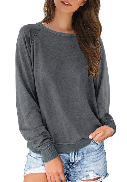 Front view of model wearing grey french terry crewneck pullover sweatshirt