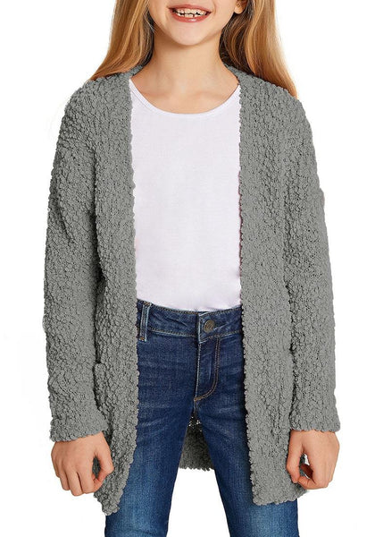 Front view of model wearing grey fuzzy fleece open-front girls' cardigan