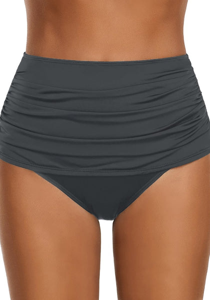 Front view of model wearing grey high waist ruched swim bottom