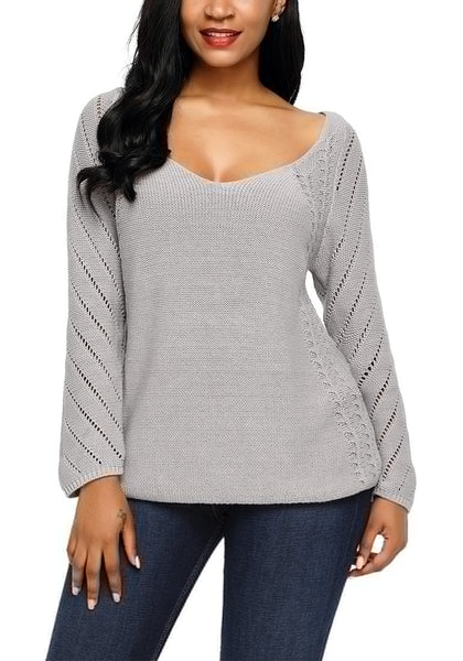 Front view of model wearing grey hollow out cotton sweater