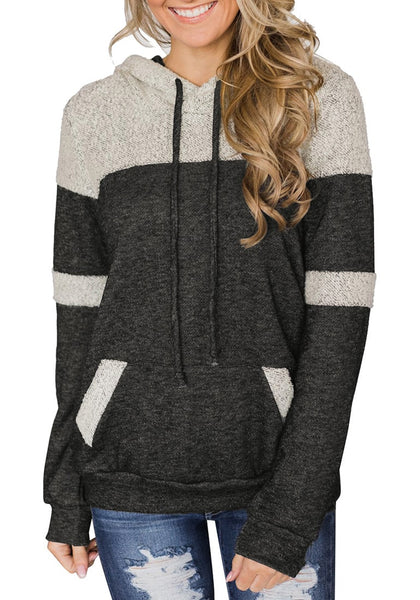 Front view of model wearing grey kangaroo pocket color block pullover hoodie top