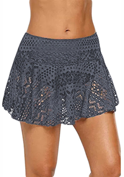 Front view of model wearing grey lace crochet swim skirt