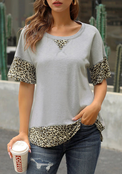 Front view of model wearing grey leopard patchwork half sleeves loose top