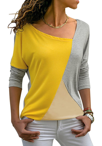 Front view of model wearing grey long sleeves color block tunic top
