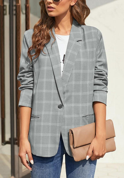 Front view of model wearing grey notch lapel single-button plaid blazer
