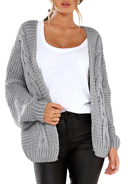Front view of model wearing grey open-front chunky knit sweater cardigan