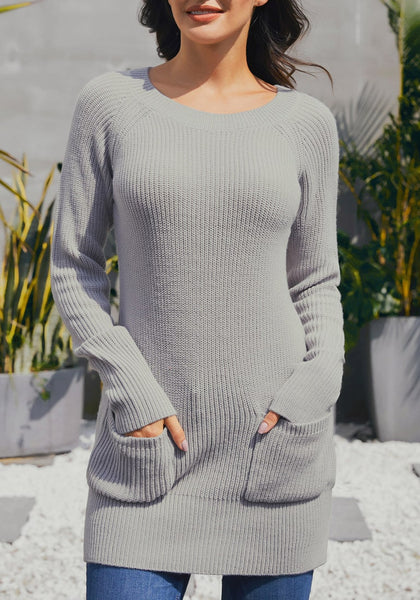 Front view of model wearing grey pockets textured ribbed knit tunic sweater