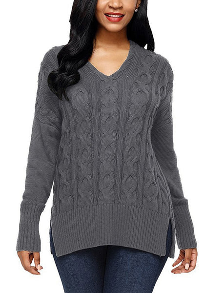 Front view of model wearing grey ribbed cable knit side-slit sweater