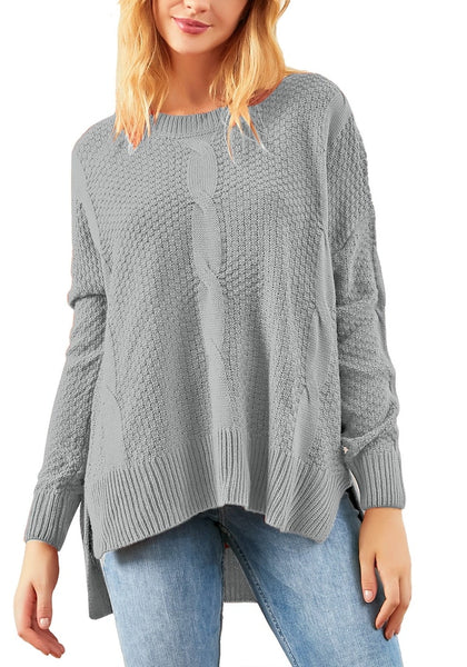 Front view of model wearing grey ribbed knit textured side-slit sweater
