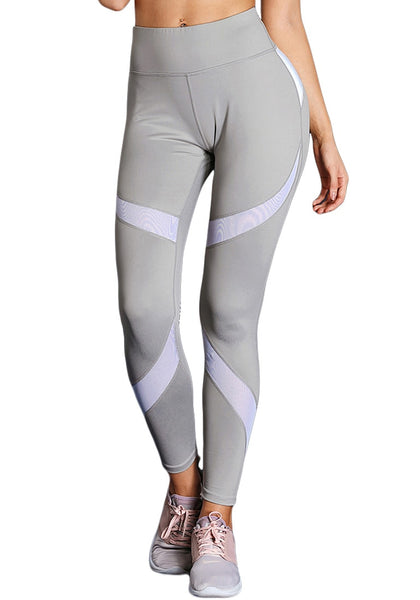 Front view of model wearing grey splice high-waist workout leggings