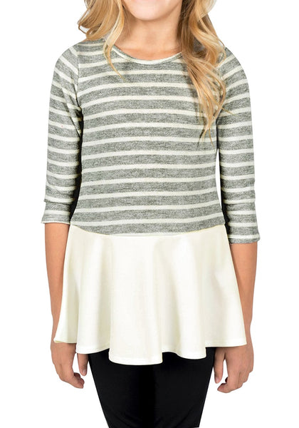 Front view of model wearing grey striped ruffle hem flared girl tunic top