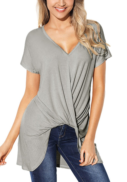 Front view of model wearing grey twist-front high-low blouse