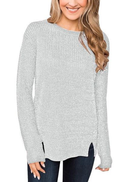 Front view of model wearing grey velvet knit side-slit pullover sweater
