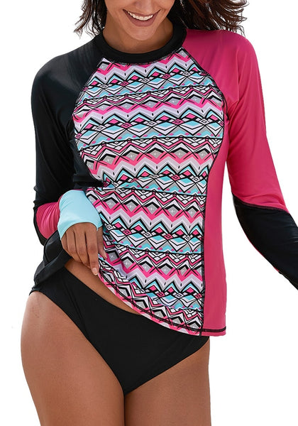 Front view of model wearing hot pink geometric-print long sleeves color block rash guard