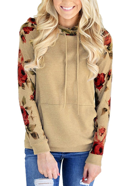 Front view of model wearing khaki floral long sleeves pocket pullover hoodie