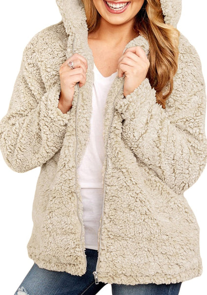 Front view of model wearing khaki zip-up oversized faux fur hooded jacket