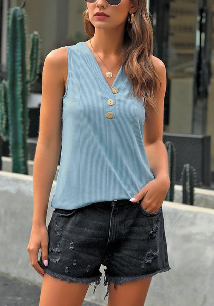 Front view of model wearing light blue V-neck buttons sleeveless knit top