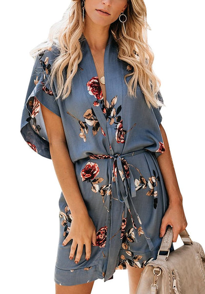Front view of model wearing light blue V-neck floral belted kimono dress