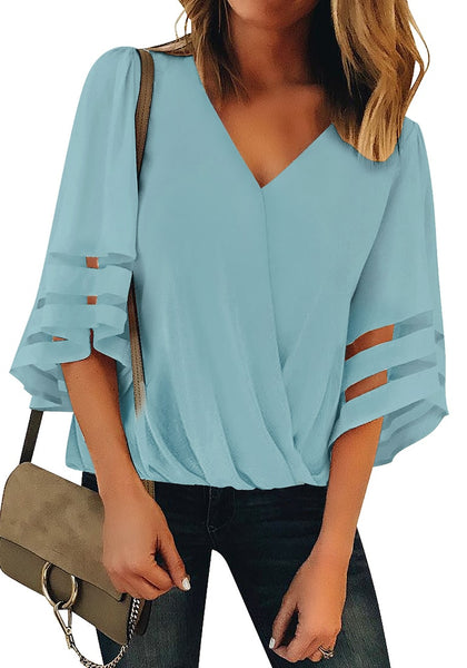 Front  view of model wearing light blue V-neckline mesh bell sleeves loose wrap blouse
