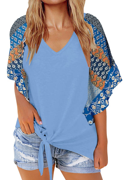 Front view of model wearing light blue boho-print flutter raglan sleeves tie-front top
