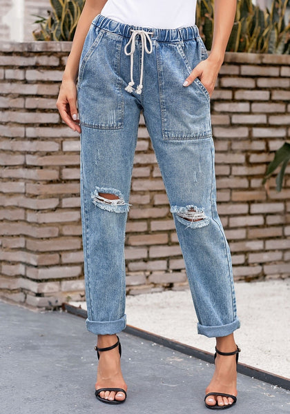 Front view of model wearing light blue drawstring-waist cuffed ripped boyfriend jeans