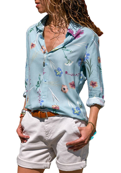 Front view of model wearing light blue floral long sleeves collared button-up top