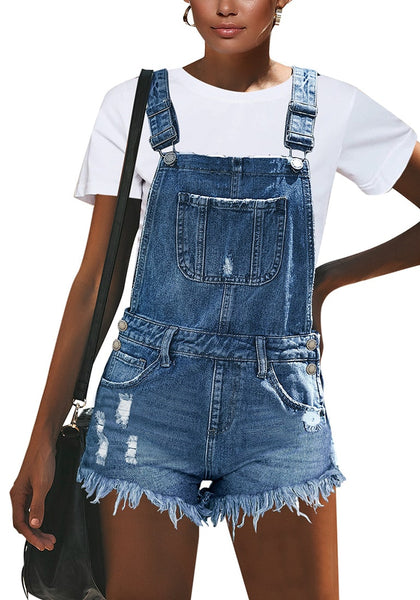 Front view of model wearing light blue frayed raw hem denim shorts overall
