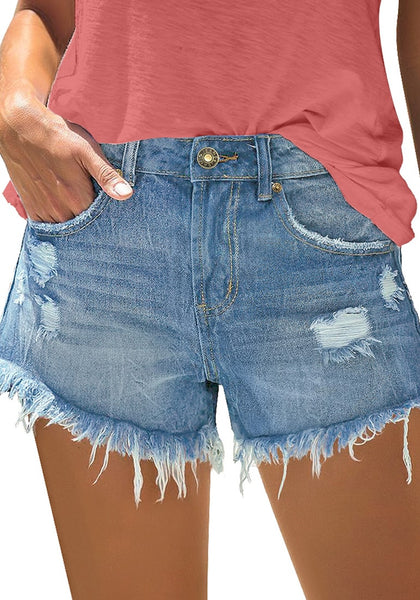 Front view of model wearing light blue frayed raw hem ripped denim shorts