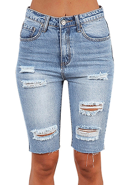 Front view of model wearing light blue ripped knee-length washed jeans shorts