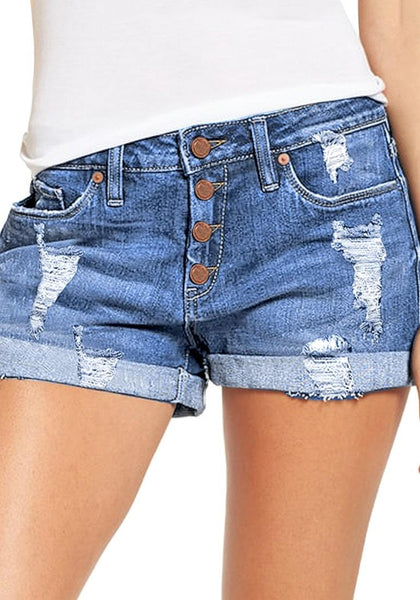 Front view of model wearing light blue roll-over hem button-up distressed denim shorts