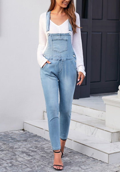 Front view of model wearing light blue rolled hem skinny denim bib overall jumpsuit