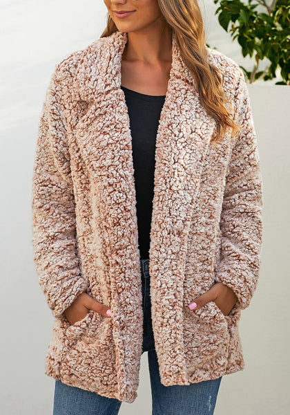 Front view of model wearing light brown notched lapel double breasted fuzzy fleece coat