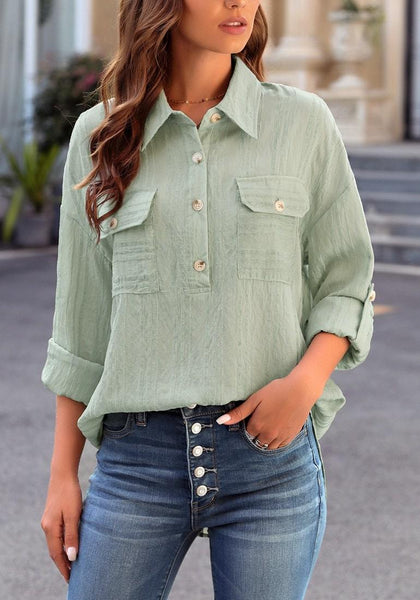 Front view of model wearing light green long sleeves half button-up tunic shirt