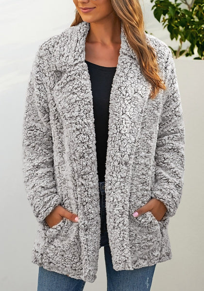 Front view of model wearing light grey notched lapel double breasted fuzzy fleece coat