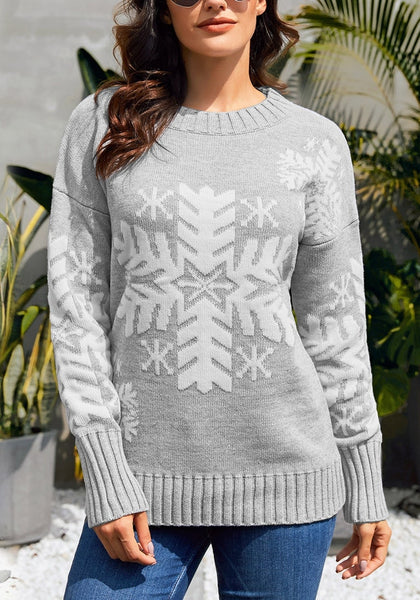 Front view of model wearing light grey snowflake ribbed knit Christmas sweater