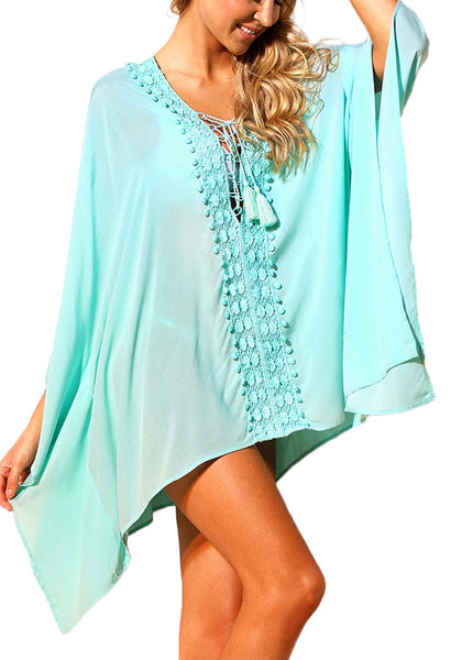 Front view of model wearing mint lace-up batwing sleeves beach cover-up