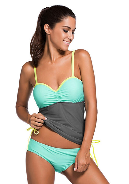 Front view of model wearing mint ruched tankini set