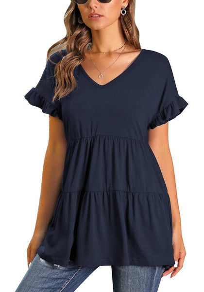 Front view of model wearing navy V-neck ruffled short sleeves tiered tunic top