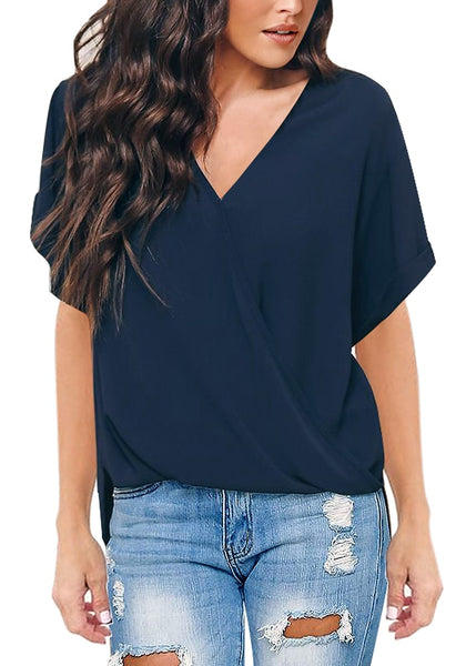 Front view of model wearing navy V-neckline cuffed sleeves loose wrap blouse