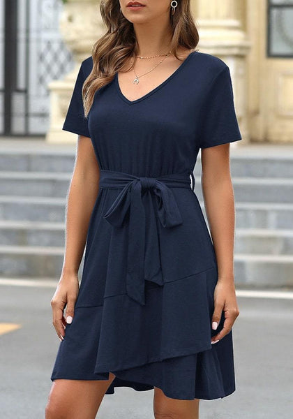 Front view of model wearing navy V-neckline short sleeves belted ruffle dress