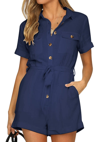 Front view of model wearing navy blue short sleeves button-down belted romper