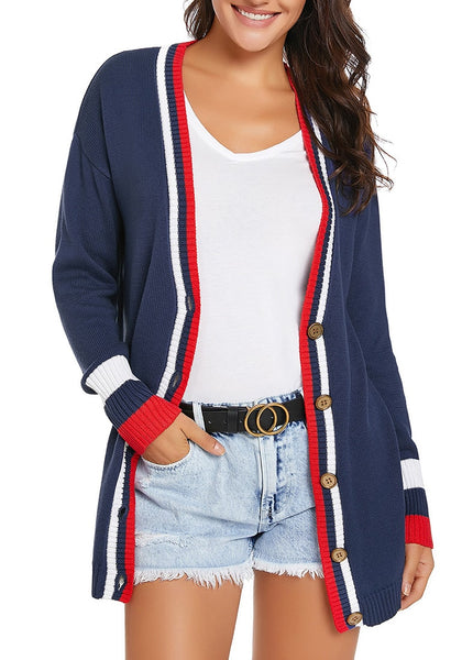 Front view of model wearing navy blue striped trim button-up knit cardigan