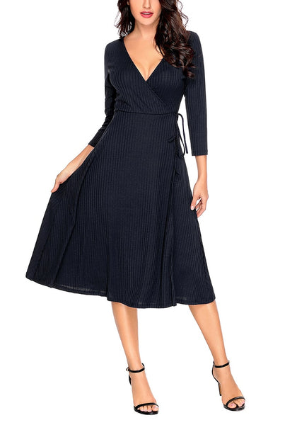Front view of model wearing navy bowknot textured faux wrap dress