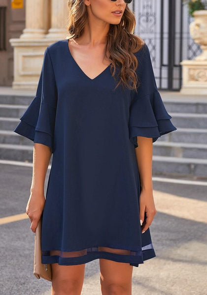 Front view of model wearing  navy flare sleeves mesh panel V-neckline shift dress