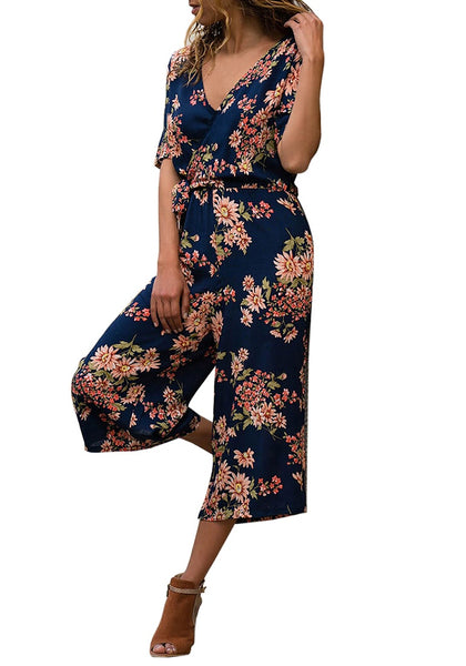 Front view of model wearing navy floral-print wide-leg surplice jumpsuit
