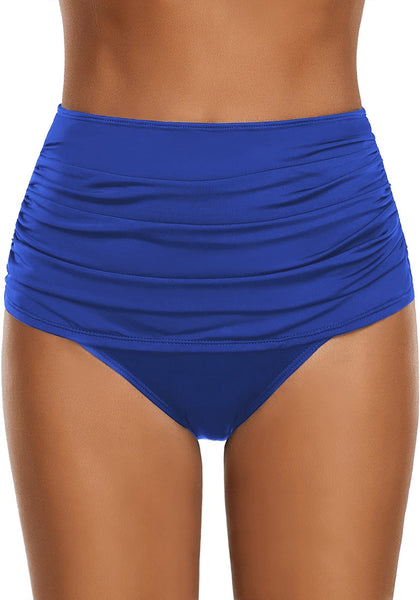 Front view of model wearing navy high waist ruched swim bottom