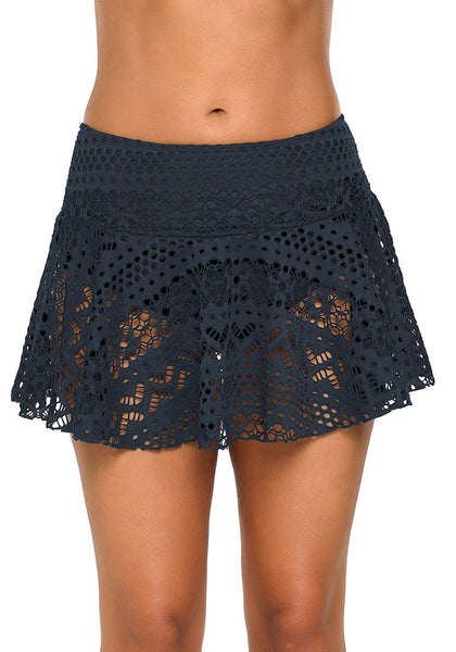 Front view of model wearing navy lace crochet swim skirt bottom