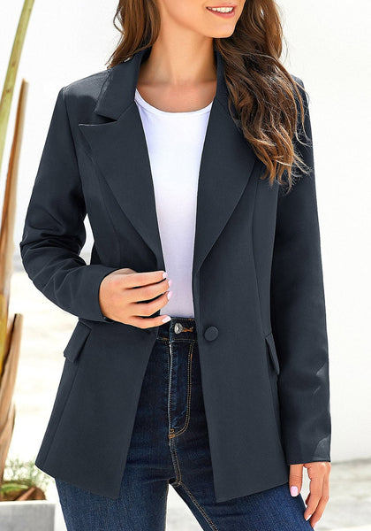 Front view of model wearing navy lapel front-button side-pockets blazer