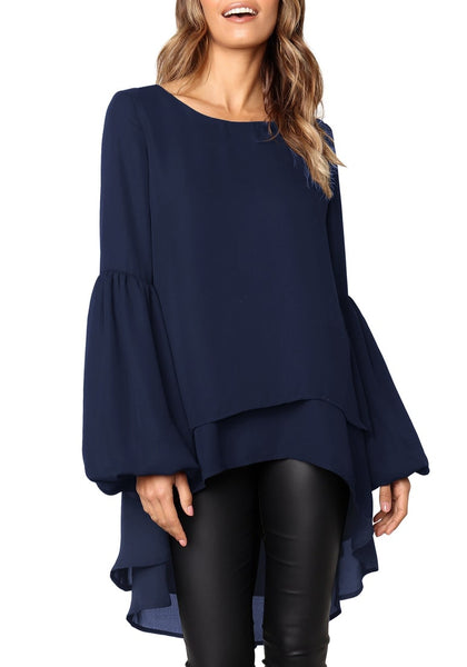 Front view of model wearing navy long lantern sleeves layered high-low blouse