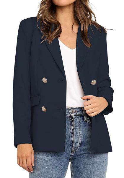 Front view of model wearing navy notch lapel double-breasted blazer